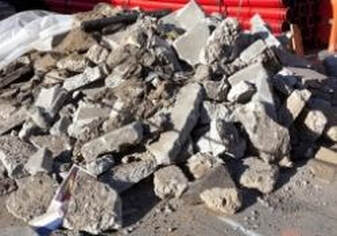 Concrete debris waiting to be loaded into a dumpster.